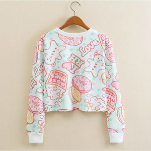 Short sweater top with sweets print NWOT